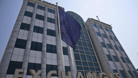 A European Union flag flutters outside the Athens stock exchange