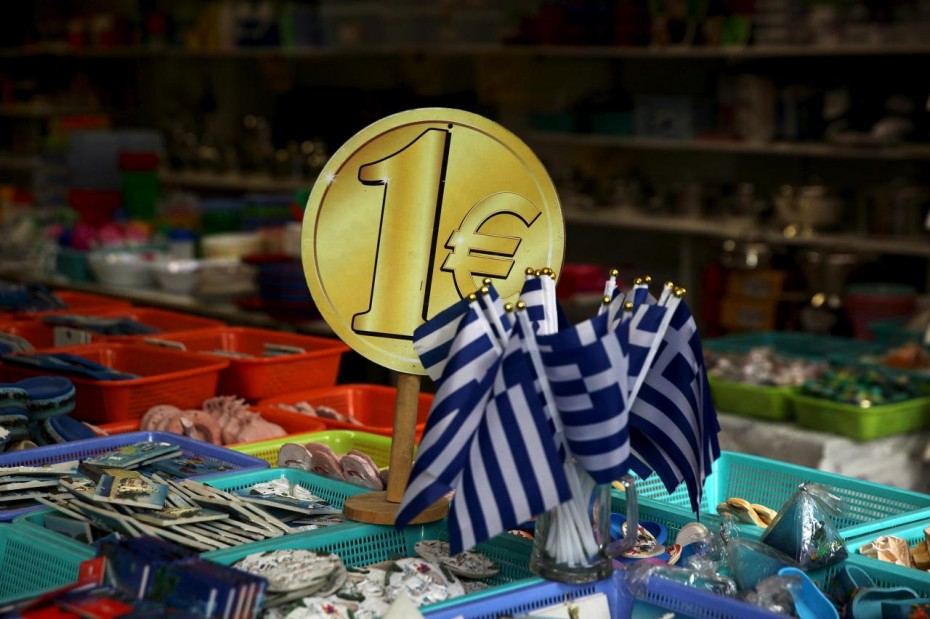 FILE PHOTO:  Greek flags are displayed for sale for one Euro at a shop in Athens