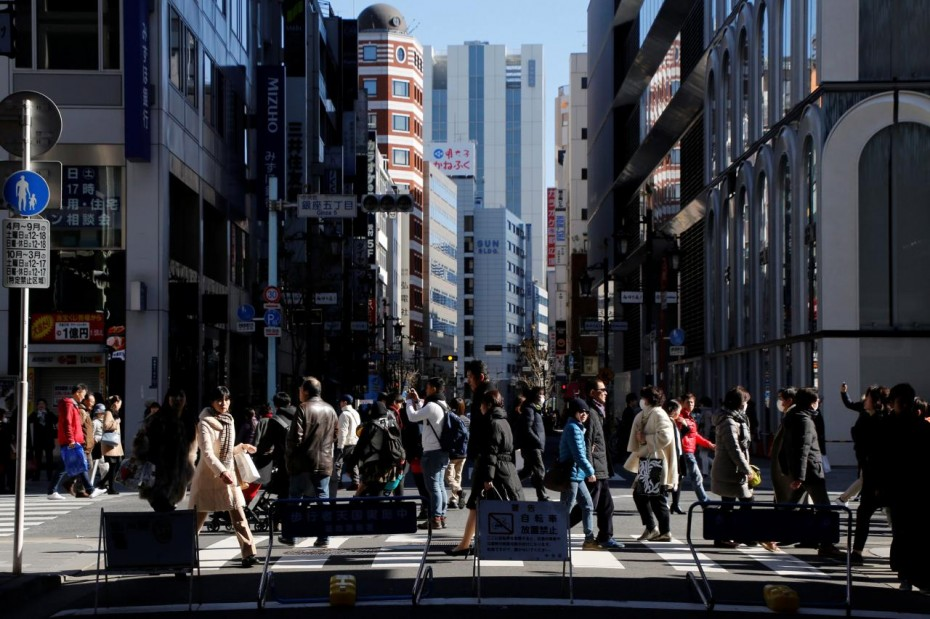 People walk on a street at Tokyo's Ginza shopping district