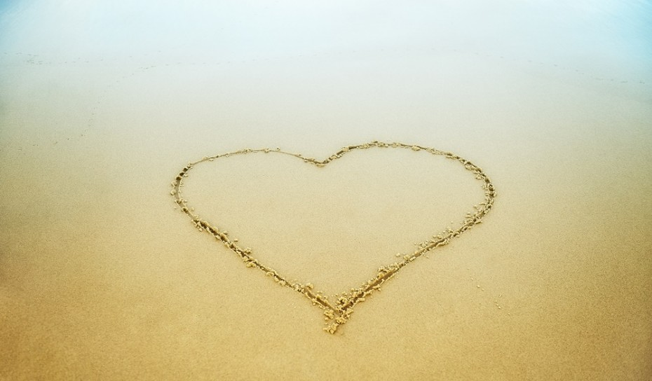 Heart drawn in the beach sand