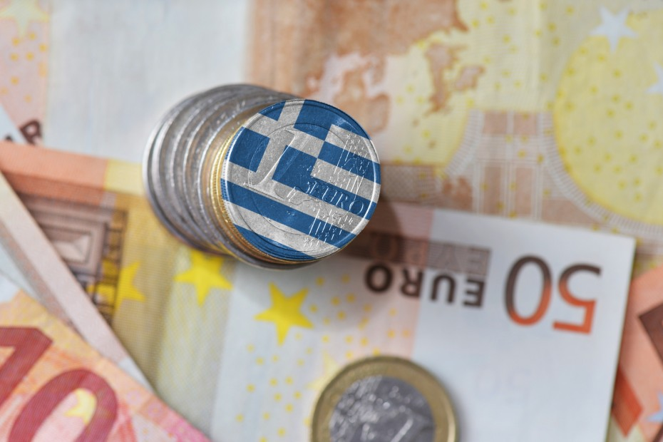 euro coin with national flag of greece on the euro money banknotes background.