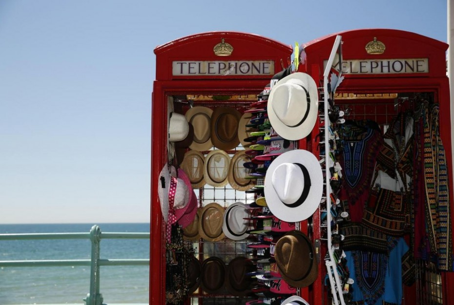 Sun hats are seen for sale in converted telephone boxes on a hot Summer day at Brighton beach