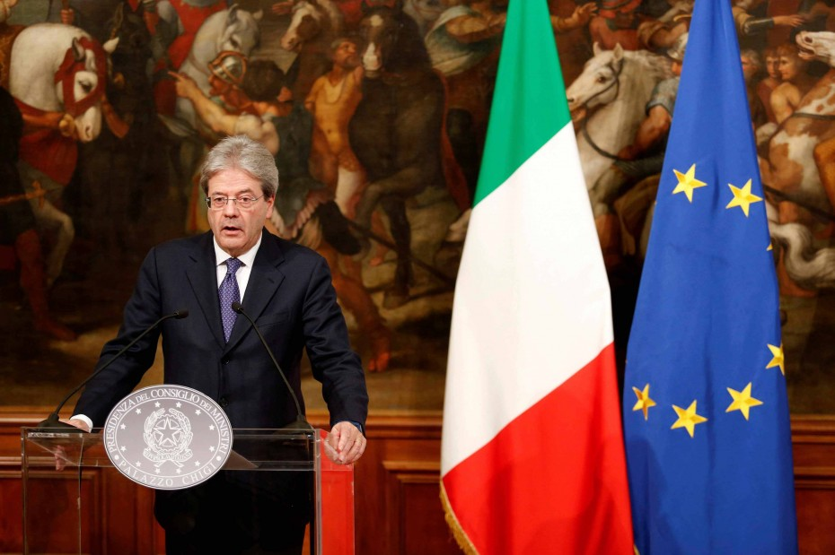 FILE PHOTO: Italian Prime Minister Paolo Gentiloni attends a news conference
