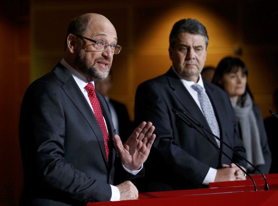 Former president of the European Parliament Schulz speaks next to German Economy Minister and Leader of the SPD party Gabriel during a news conference in Berlin