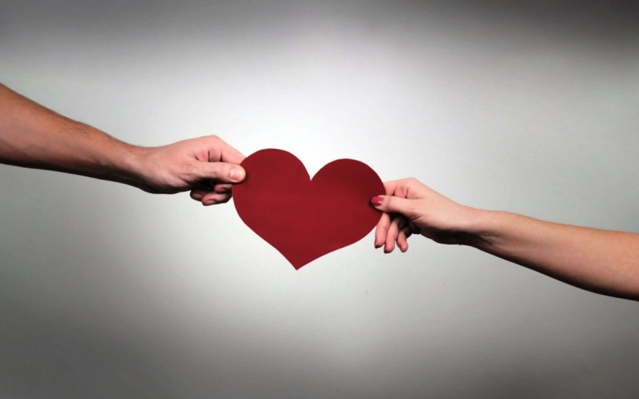 man-woman-hold-heart-paper