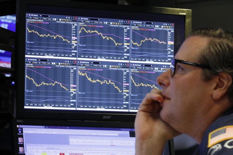 Πτωτικά μεν, ψύχραιμα δε για το άνοιγμα της Wall Street