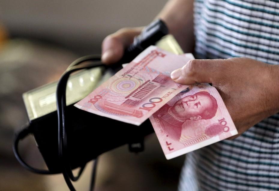 «Βουτιά» σε χαμηλό 9ετίας για την ισοτιμία γουάν-δολαρίου
